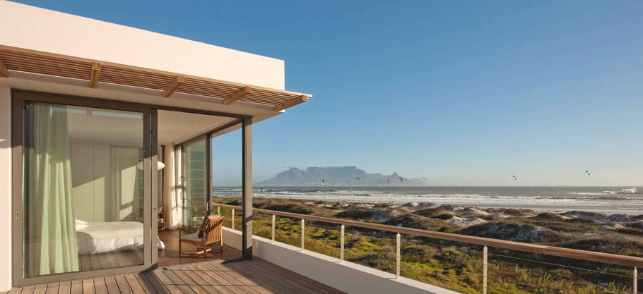 Big bay beach house with wow factor views of cape town for Beach house design cape town