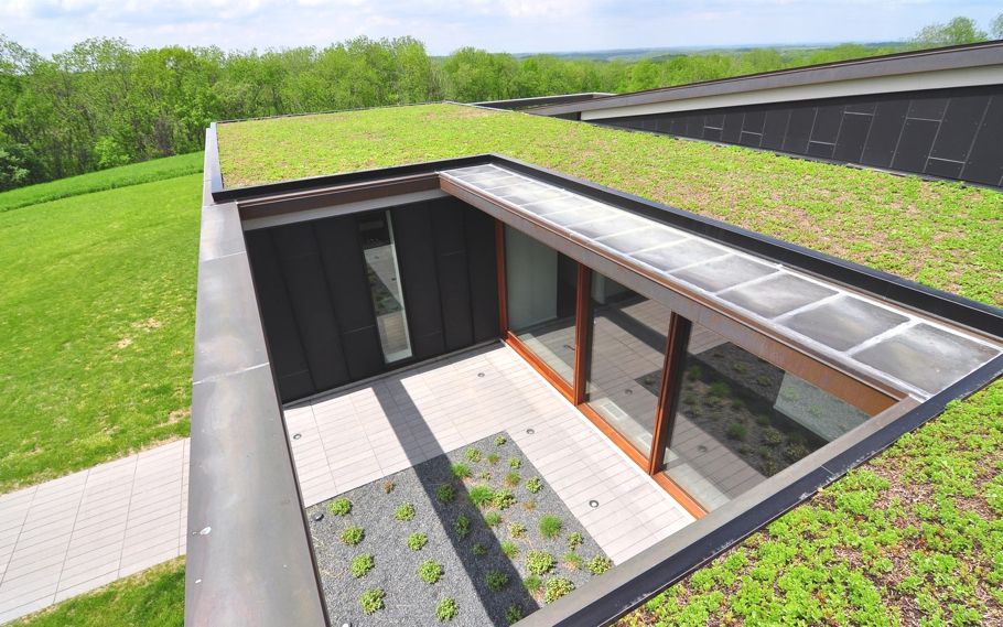 Topo house built to enjoy wisconsin 39 s rolling hills for Contemporary home builders wisconsin