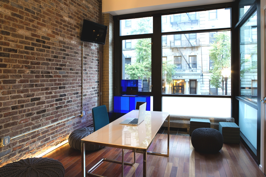 Modern renovation of s i n s outdated office in nyc for Interior design fees nyc